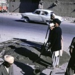 Afghan workers make a street repair in Kabul.
