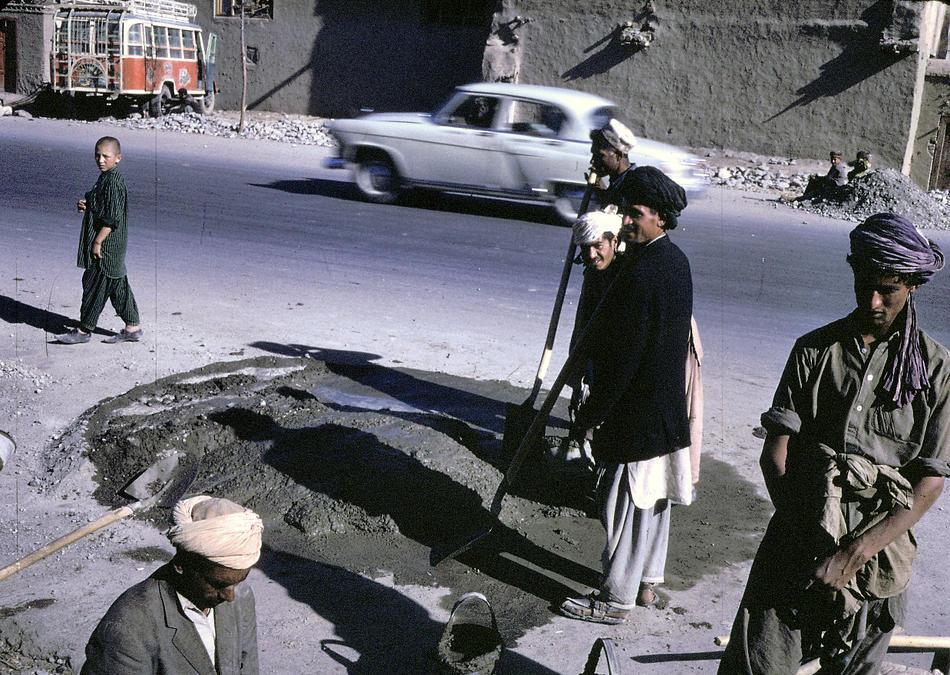Afghan workers make a street repair in Kabul.