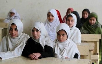 Afghan students enjoy a roof over their heads at school