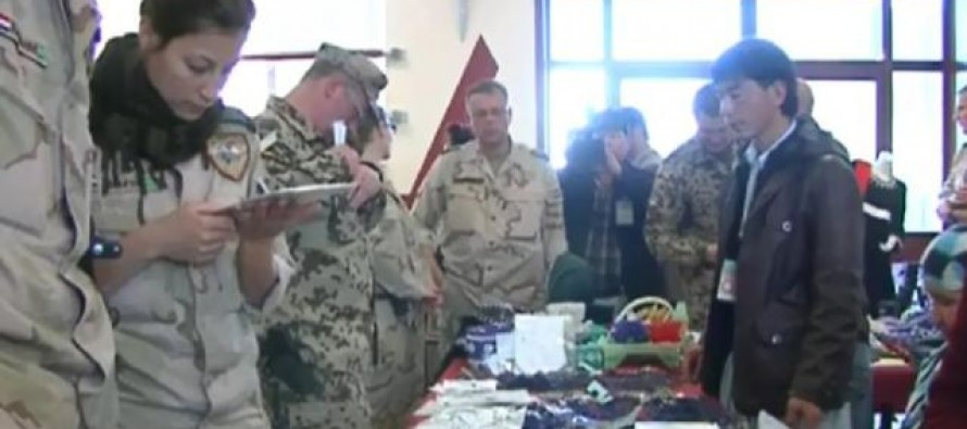 Exhibition of Afghan women's handicrafts in an ISAF camp