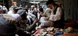 Afghani Value Falls Against Dollar As US Slashes $1bn in Aid